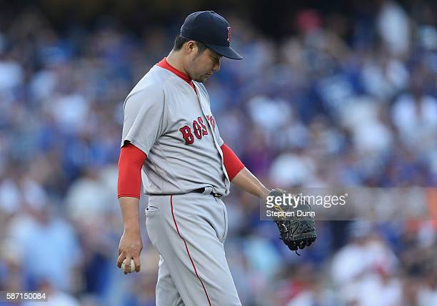 Relief pitcher Junichi Tazawa of the Boston Red Sox reacts after after giving up a home run to Kike Hernandez of the Los Angeles Dodgers, the second...