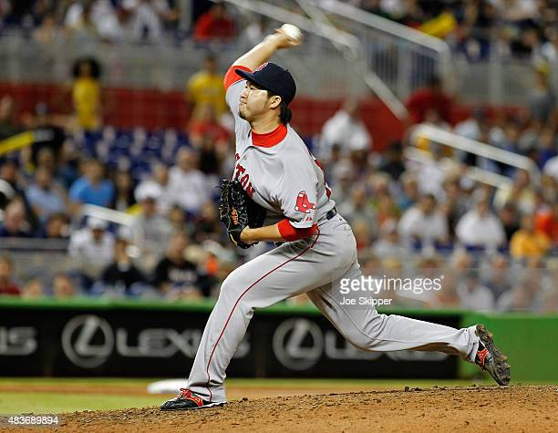 Relief pitcher Junichi Tazawa of the Boston Red Sox throws in the ninth inning against the Miami Marlins at Marlins Park on August 11, 2015 in Miami,...