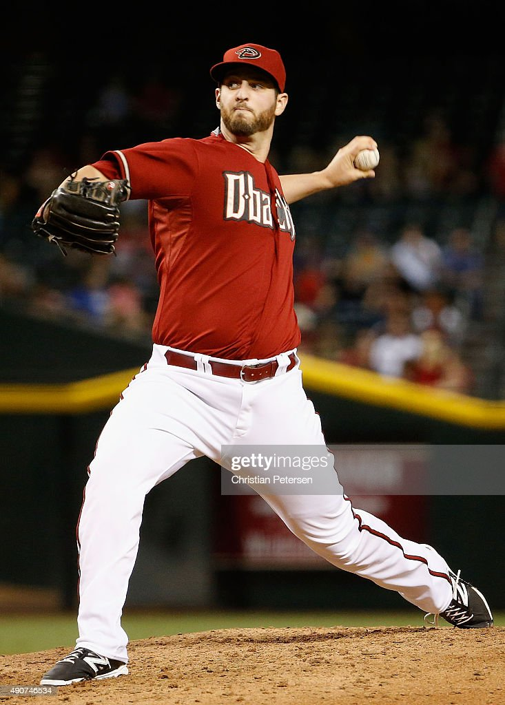 Relief pitcher Keith Hessler #56 of the Arizona Diamondbacks pitches against the Colorado Rockies during the sixth inning of the MLB game at Chase Field on September 30, 2015 in Phoenix, Arizona.