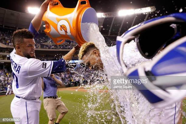Relief pitcher Kelvin Herrera of the Kansas City Royals douses game MVP catcher Salvador Perez after the Royals defeated the San Francisco Giants 20...