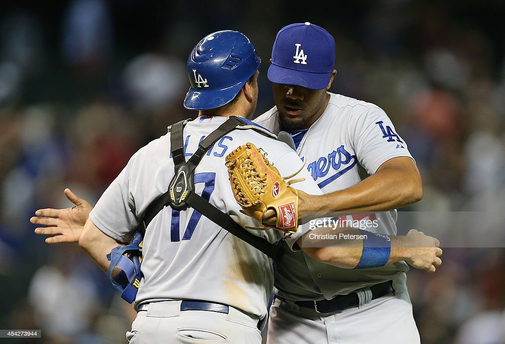 Relief pitcher Kenley Jansen #74 of the Los Angeles Dodgers celebrates with catcher A.J. Ellis #17 after defeating the Arizona Diamondbacks 3-1 in the MLB game at Chase Field on August 27, 2014 in Phoenix, Arizona.