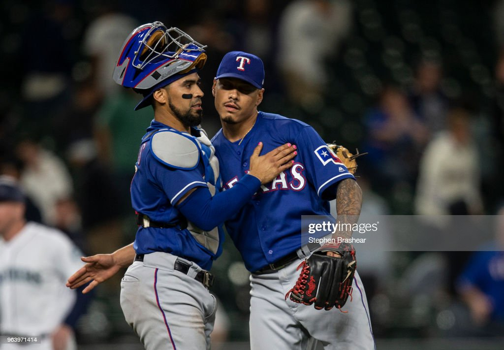 Relief pitcher Keone Kela #50 of the Texas Rangers gets a hug from catcher after a game against the Seattle Mariners at Safeco Field on May 30, 2018 in Seattle, Washington. The Rangers won the game 7-6.