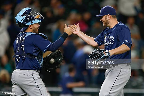 Relief pitcher Kevin Jepsen of the Tampa Bay Rays is congratulated by catcher Rene Rivera after defeating the Seattle Mariners 21 at Safeco Field on...