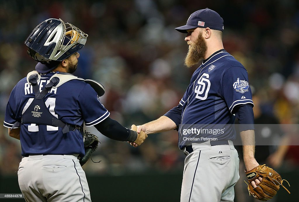 Relief pitcher Kevin Quackenbush #59 of the San Diego Padres celebrates with catcher Rene Rivera #44 after defeating the Arizona Diamondbacks 6-5 in the MLB game at Chase Field on September 12, 2014 in Phoenix, Arizona.