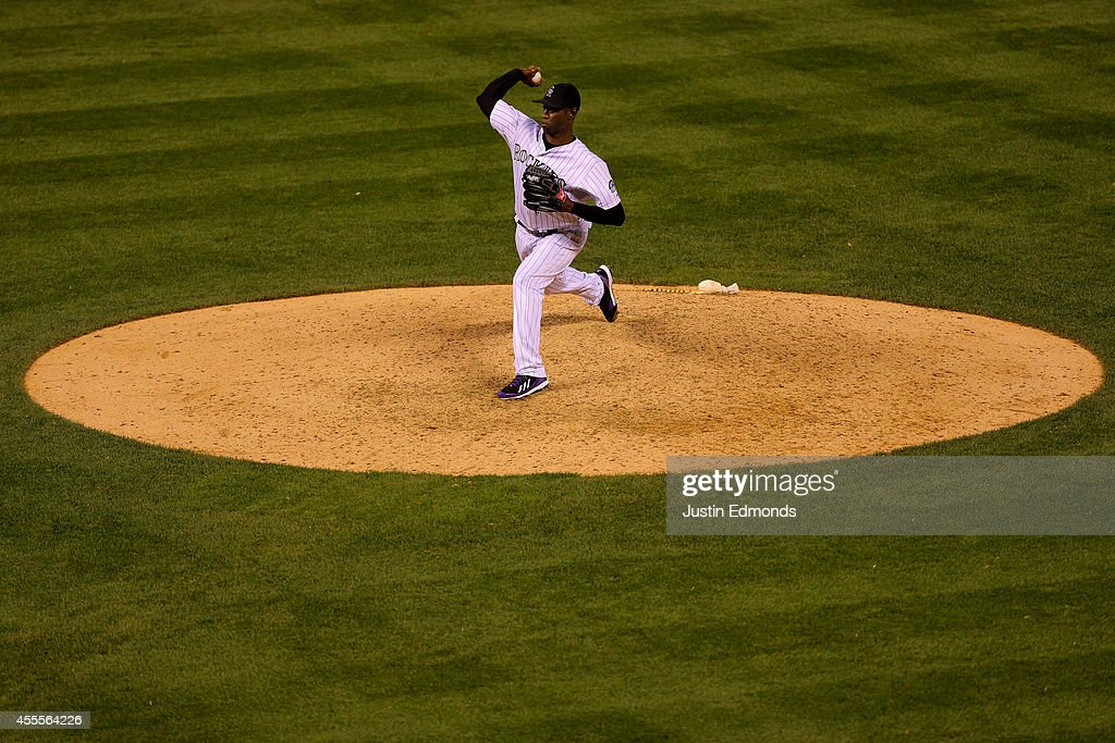 Relief pitcher LaTroy Hawkins #32 of the Colorado Rockies delivers to home plate during the ninth inning against the Los Angeles Dodgers at Coors Field on September 16, 2014 in Denver, Colorado. The Rockies defeated the Dodgers 10-4.