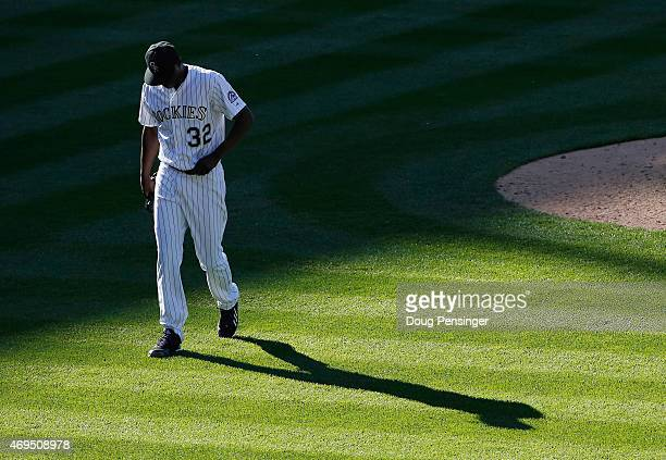 Relief pitcher LaTroy Hawkins of the Colorado Rockies walks off the mound in the ninth inning against the Chicago Cubs at Coors Field on April 12,...