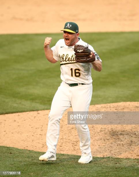 Relief pitcher Liam Hendriks of the Oakland Athletics celebrates after they beat the Chicago White Sox 6-4 in Game Three of the American League wild...