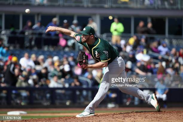 Relief pitcher Liam Hendriks of the Oakland Athletics pitches against the Seattle Mariners during the MLB spring training game at Peoria Stadium on...