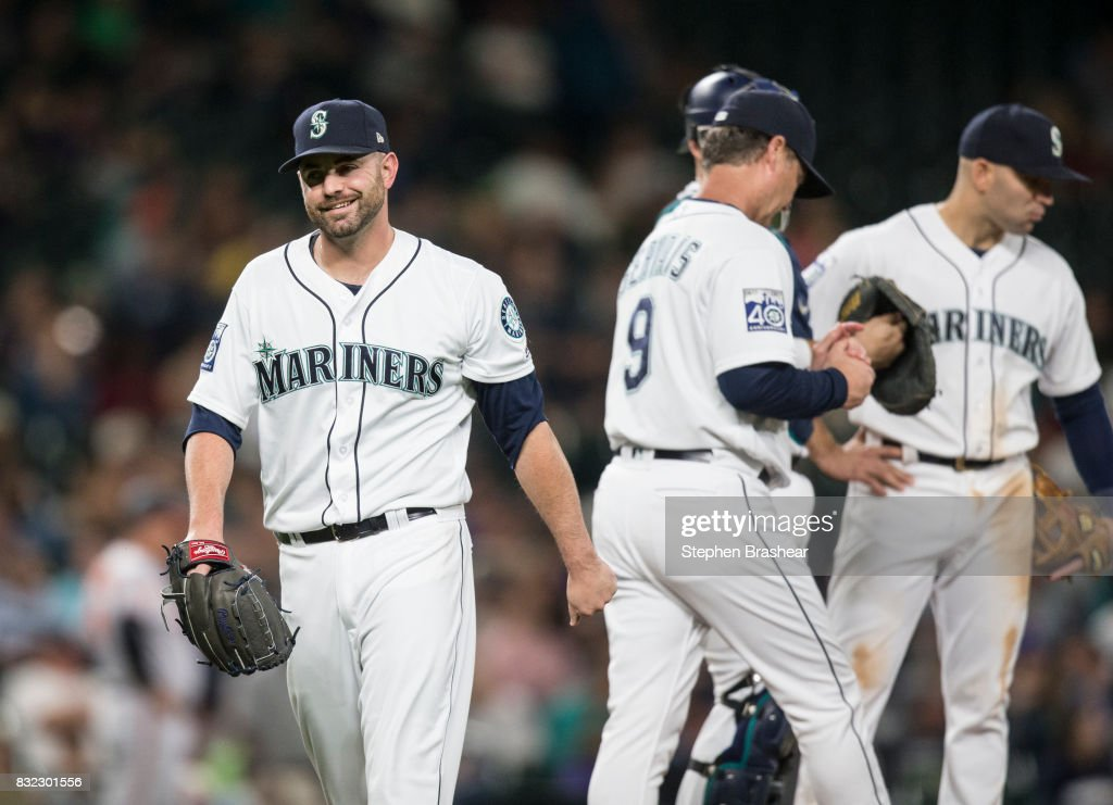 Relief pitcher Marc Rzepczynski #25 of the Seattle Mariners smiles as he leaves after facing one batter during the eighth inning of a game against the Baltimore Orioles at Safeco Field on August 15, 2017 in Seattle, Washington. The Mariners won 3-1.
