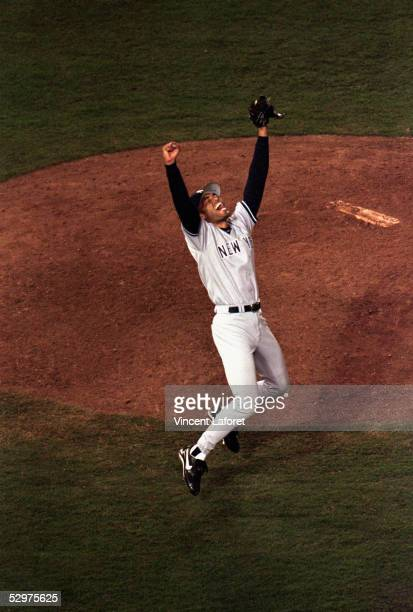 Relief pitcher Mariano Rivera of the New York Yankees rejoices after the last out of game four of the World Series against the San Diego Padres at...