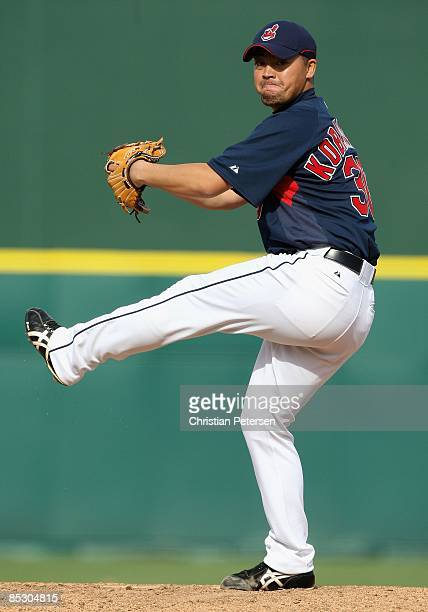 Relief pitcher Masa Kobayashi of the Cleveland Indians pitches against the Milwaukee Brewers during the spring training game at Goodyear Ballpark on...