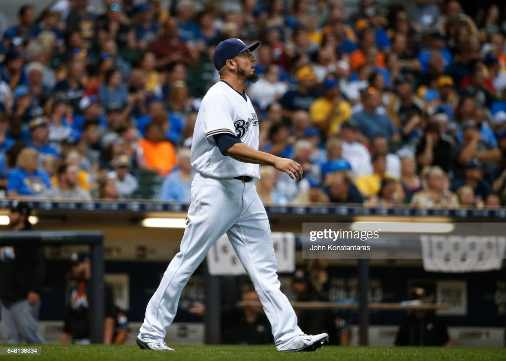 Relief pitcher Matt Garza #22 of the Milwaukee Brewers walks back to the mound after giving up a run during the seventh inning against the Miami Marlins at Miller Park on September 16, 2017 in Milwaukee, Wisconsin. The Marlins defeated the Brewers 7-4.