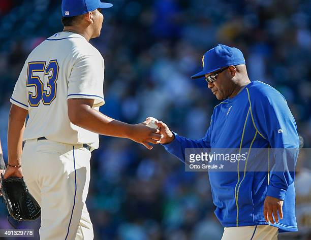Relief pitcher Mayckol Guaipe of the Seattle Mariners is removed from the game by manager Lloyd McClendon in the seventh inning against the Oakland...