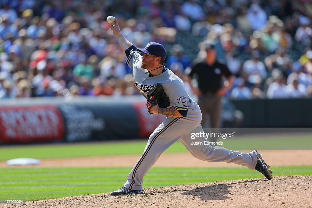 Relief pitcher Michael Blazek #54 of the Milwaukee Brewers delivers to home plate during the seventh inning against the Colorado Rockies at Coors Field on June 20, 2015 in Denver, Colorado. The Rockies defeated the Brewers 5-1.