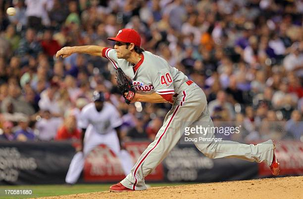Relief pitcher Michael Stutes of the Philadelphia Phillies delivers against the Colorado Rockies at Coors Field on June 14 2013 in Denver Colorado...