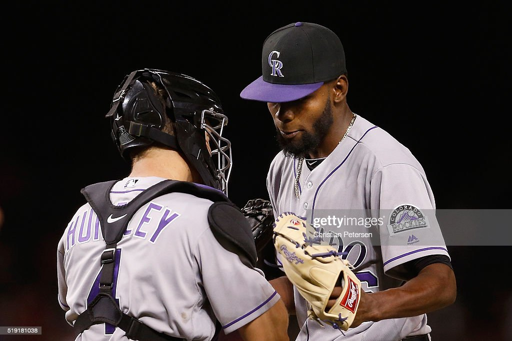 Relief pitcher Miguel Castro #46 of the Colorado Rockies high-fives catcher Nick Hundley #4 after defeating the Arizona Diamondbacks 10-5 in the MLB opening day game at Chase Field on April 4, 2016 in Phoenix, Arizona.