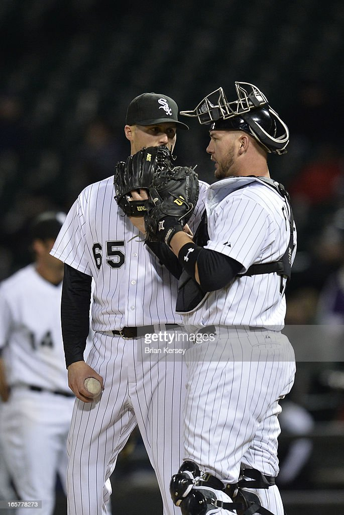 Relief pitcher Nate Jones #65 of the Chicago White Sox (L) and catcher Tyler Flowers #21 talk on the mound during the tenth inning against the Seattle Mariners on April 5, 2012 at U.S. Cellular Field in Chicago, Illinois. The Mariners won 8-7 in 10 innings.