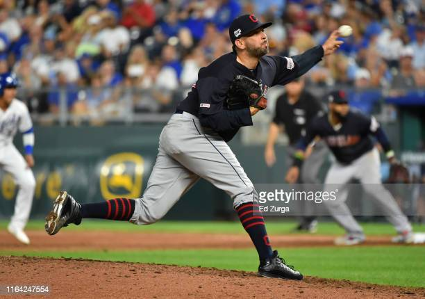Relief pitcher Oliver Perez of the Cleveland Indians throws in the seventh inning against the Kansas City Royals at Kauffman Stadium on July 25 2019...