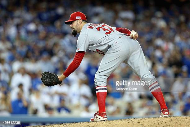 Relief pitcher Pat Neshek of the St Louis Cardinals gets set to throw a pitch against the Los Angeles Dodgers in the eighth inning of Game One of the...
