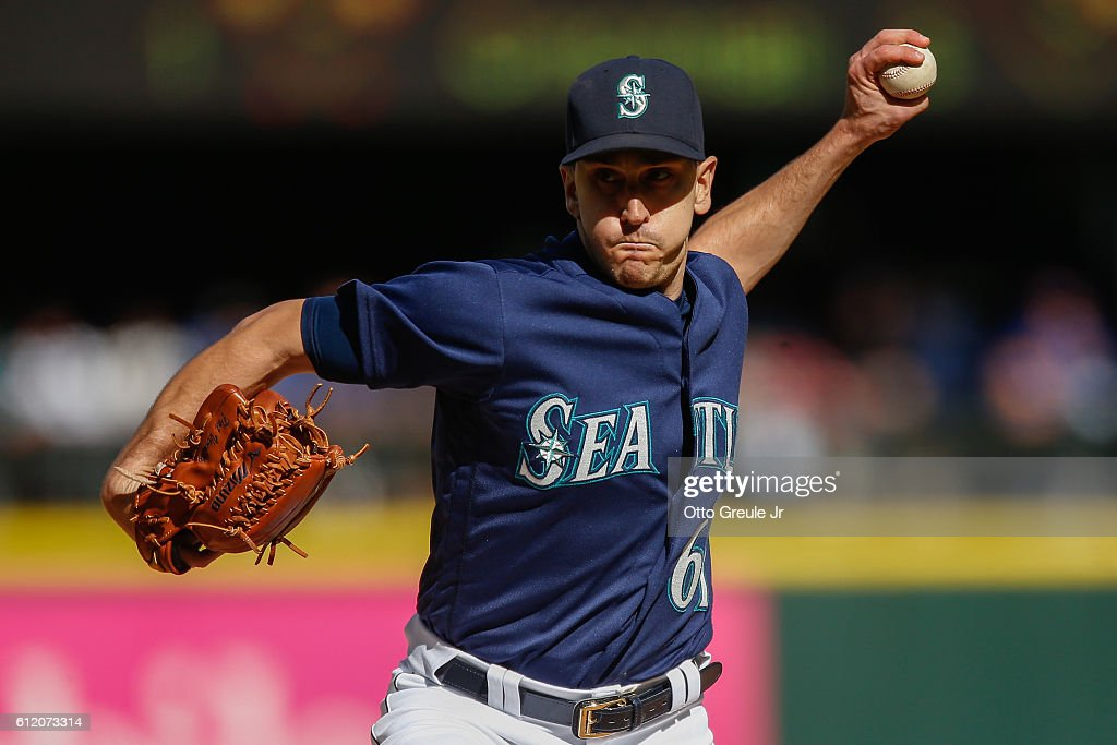 Relief pitcher Pat Venditte #61 of the Seattle Mariners pitches against the Oakland Athletics in the fourth inning at Safeco Field on October 2, 2016 in Seattle, Washington. The Athletics defeated the Mariners 3-2.