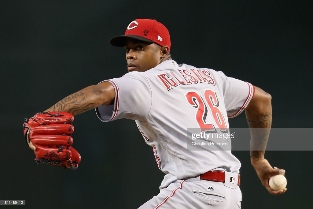 Relief pitcher Raisel Iglesias #26 of the Cincinnati Reds throws a warm up pitch before the ninth inning of the MLB game against the Arizona Diamondbacks at Chase Field on July 9, 2017 in Phoenix, Arizona.