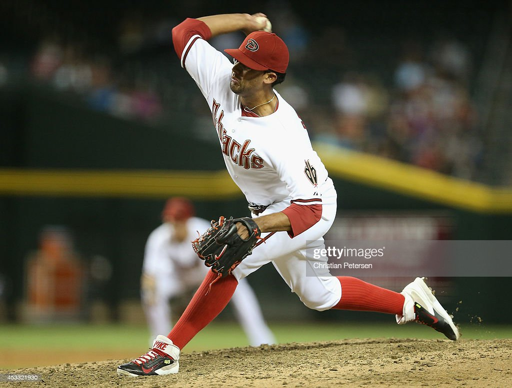 Relief pitcher Randall Delgado #48 of the Arizona Diamondbacks pitches against the Kansas City Royals during the MLB game at Chase Field on August 7, 2014 in Phoenix, Arizona. The Royals defeated the Diamondbacks 6-2.