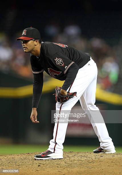 Relief pitcher Randall Delgado of the Arizona Diamondbacks prepares to throw a pitch against the New York Mets during the MLB game at Chase Field on...