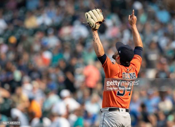 Relief pitcher Roberto Osuna of the Houston Astros celebrates after a game against the Seattle Mariners at Safeco Field on August 22 2018 in Seattle...