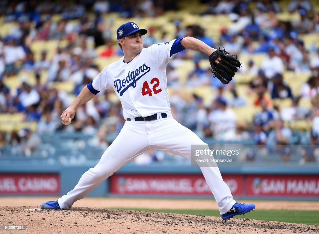 Relief pitcher Ross Stripling #68 of the Los Angeles Dodgers throws against Arizona Diamondbacks during the ninth inning at Dodger Stadium on April 15, 2018 in Los Angeles, California. All players are wearing #42 in honor of Jackie Robinson Day.