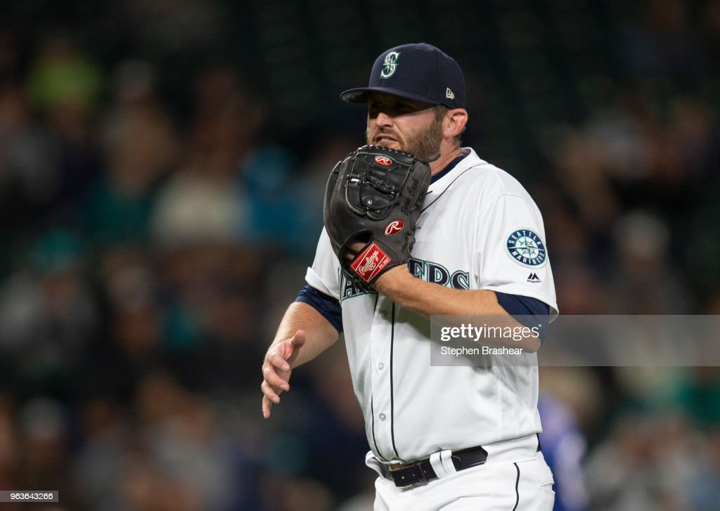 Relief pitcher Ryan Cook #46 of the Seattle Mariners reacts after the final out of the top sixth inning a game against the Texas Rangers at Safeco Field on May 29, 2018 in Seattle, Washington.