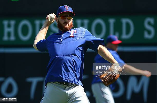 Relief pitcher Sam Dyson of the Texas Rangers throws the ball during warmup prior to the MLB game against the Los Angeles Angels of Anaheim at Angel...