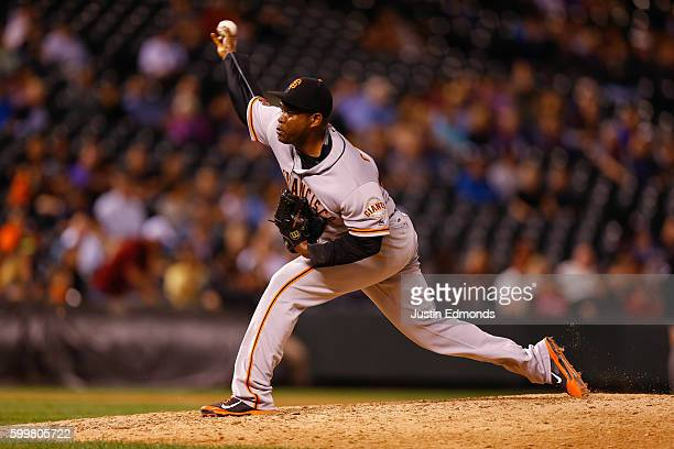 Relief pitcher Santiago Casilla of the San Francisco Giants delivers to home plate during the ninth inning against the Colorado Rockies at Coors...