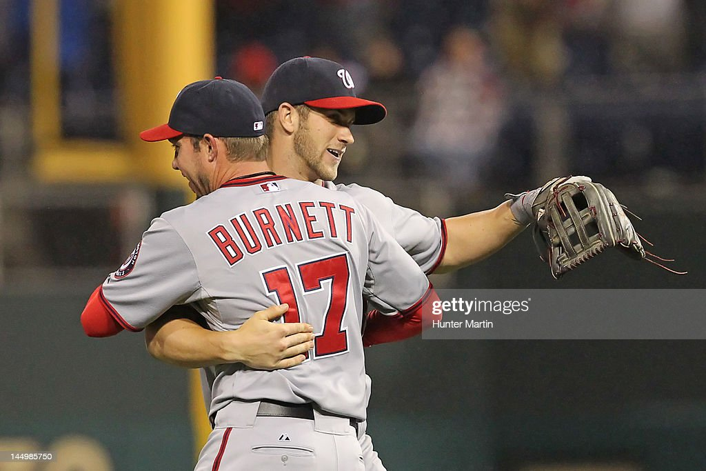 Relief pitcher Sean Burnett #17 of the Washington Nationals hugs left fielder Bryce Harper #34 after saving the game against the Philadelphia Phillies at Citizens Bank Park on May 21, 2012 in Philadelphia, Pennsylvania. The Nationals won 2-1.