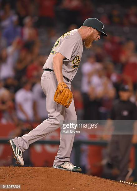 Relief pitcher Sean Doolittle of the Oakland Athletics reacts after allowing a tworun home run to Jett Bandy of the Los Angeles Angels of Anaheim...