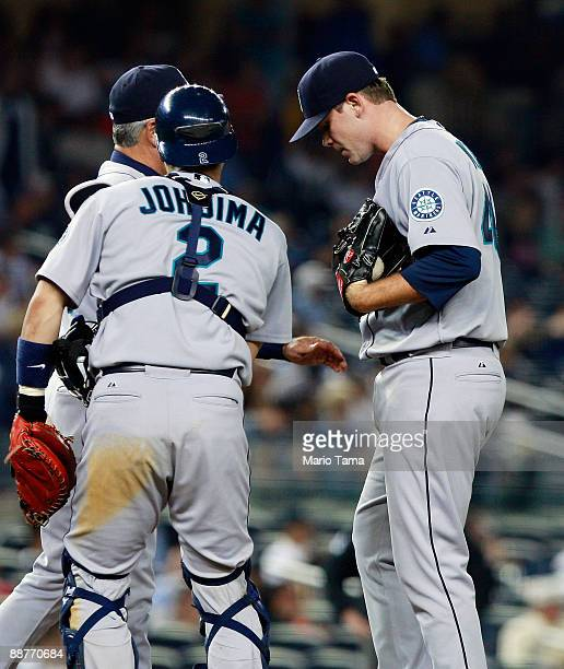 Relief pitcher Sean White of the Seattle Mariners stands on the mound with teammate catcher Kenji Johjima against the New York Yankees June 30 2009...