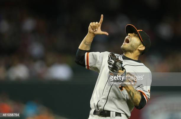 Relief pitcher Sergio Romo of the San Francisco Giants celebrates after defeating the Arizona Diamondbacks in the MLB game at Chase Field on June 22,...