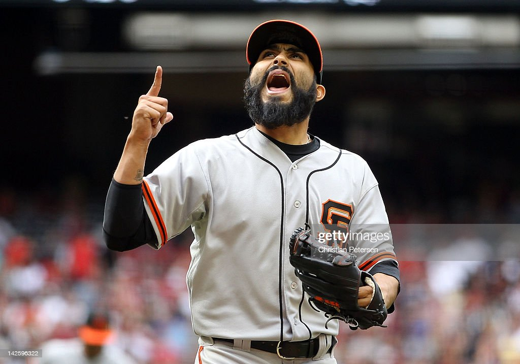 Relief pitcher Sergio Romo #54 of the San Francisco Giants reacts after getting out of the seventh inning against the Arizona Diamondbacks during the MLB game at Chase Field on April 8, 2012 in Phoenix, Arizona.