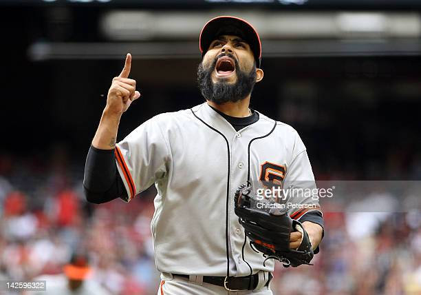 Relief pitcher Sergio Romo of the San Francisco Giants reacts after getting out of the seventh inning against the Arizona Diamondbacks during the MLB...