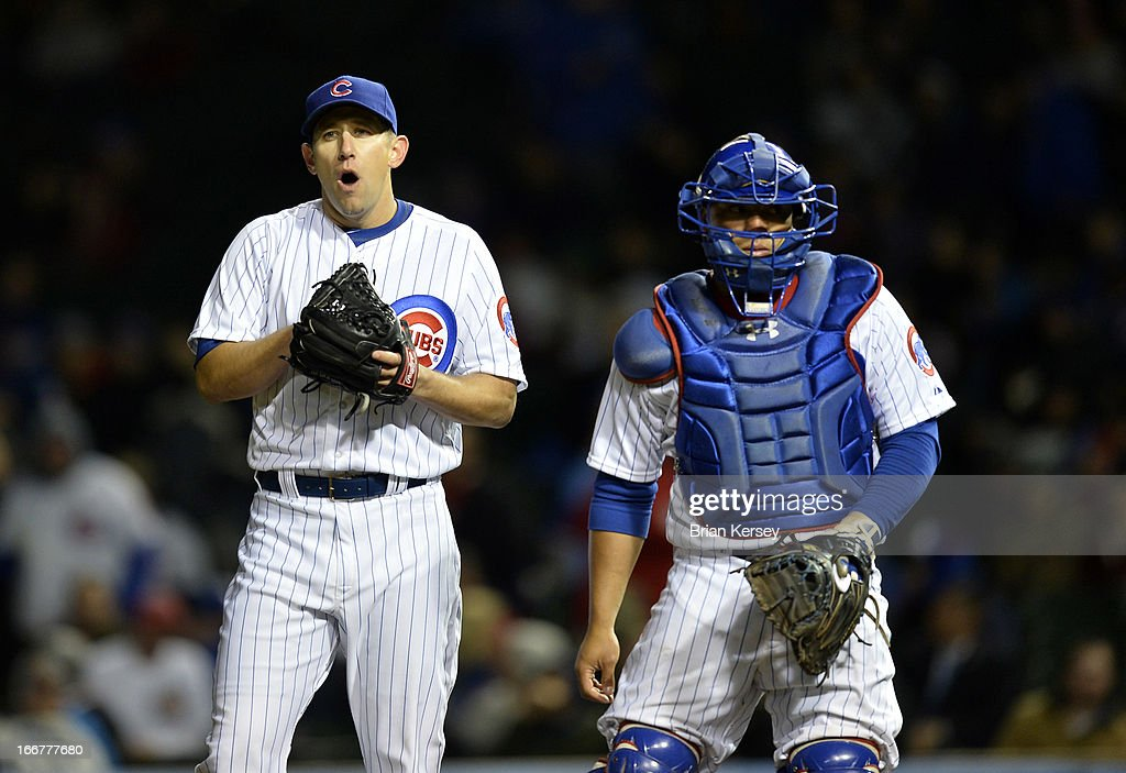 Relief pitcher Shawn Camp (L) and catcher Welington Castillo of the Chicago Cubs stand on the mound during the eighth inning against the Texas Rangers at Wrigley Field on April 16, 2013 in Chicago, Illinois. All uniformed team members are wearing jersey number 42 in honor of Jackie Robinson Day.