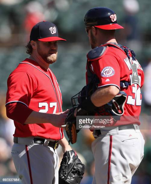 Relief pitcher Shawn Kelley of the Washington Nationals celebrates with catcher Matt Wieters after defeating the Oakland Athletics in the MLB game at...