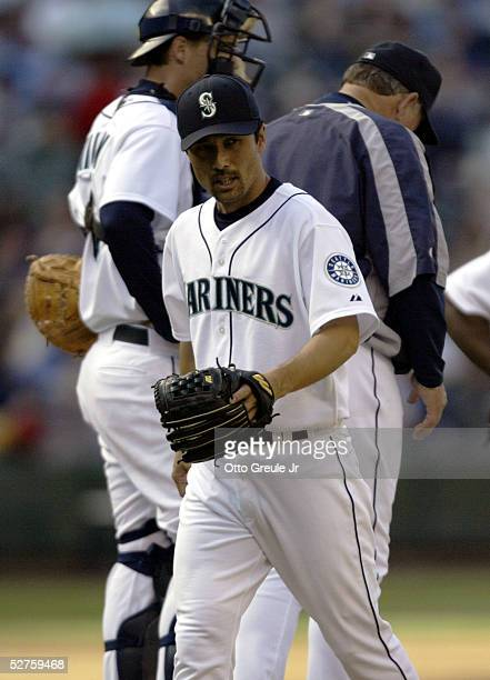Relief pitcher Shigetoshi Hasegawa of the Seattle Mariners leaves the game after going one and two thirds innings against the Los Angeles Angels of...