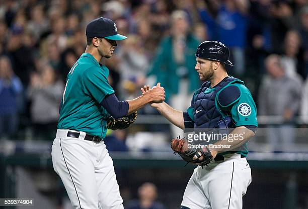 Relief pitcher Steve Cishek left of the Seattle Mariners and catcher Chris Iannetta celebrate a victory over the Texas Rangers at Safeco Field on...