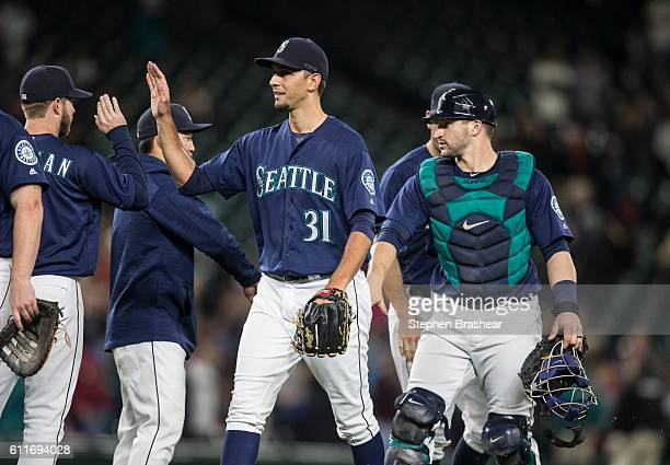 Relief pitcher Steve Cishek of the Seattle Mariners and catcher Mike Zunino right of the Seattle Mariners celebrate a win over the Oakland Athletics...
