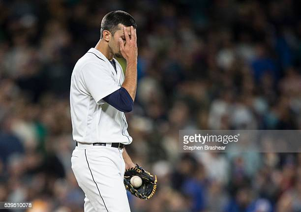 Relief pitcher Steve Cishek of the Seattle Mariners reacts after giving up home run to Prince Fielder of the Texas Rangers and blowing a save...