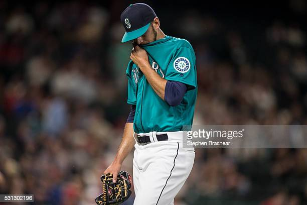 Relief pitcher Steve Cishek walks off the field after giving up a one run lead during the ninth inning of a game against the Los Angeles Angels of...