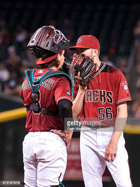 Relief pitcher Steve Hathaway and Tuffy Gosewisch of the Arizona Diamondbacks have a meeting on the mound in the seventh inning of the MLB game...