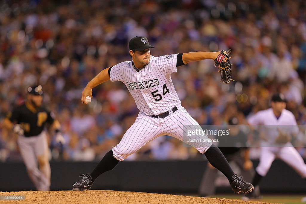 Relief pitcher Tommy Kahnle #54 of the Colorado Rockies delivers to home plate during the seventh inning against the Pittsburgh Pirates at Coors Field on July 25, 2014 in Denver, Colorado.