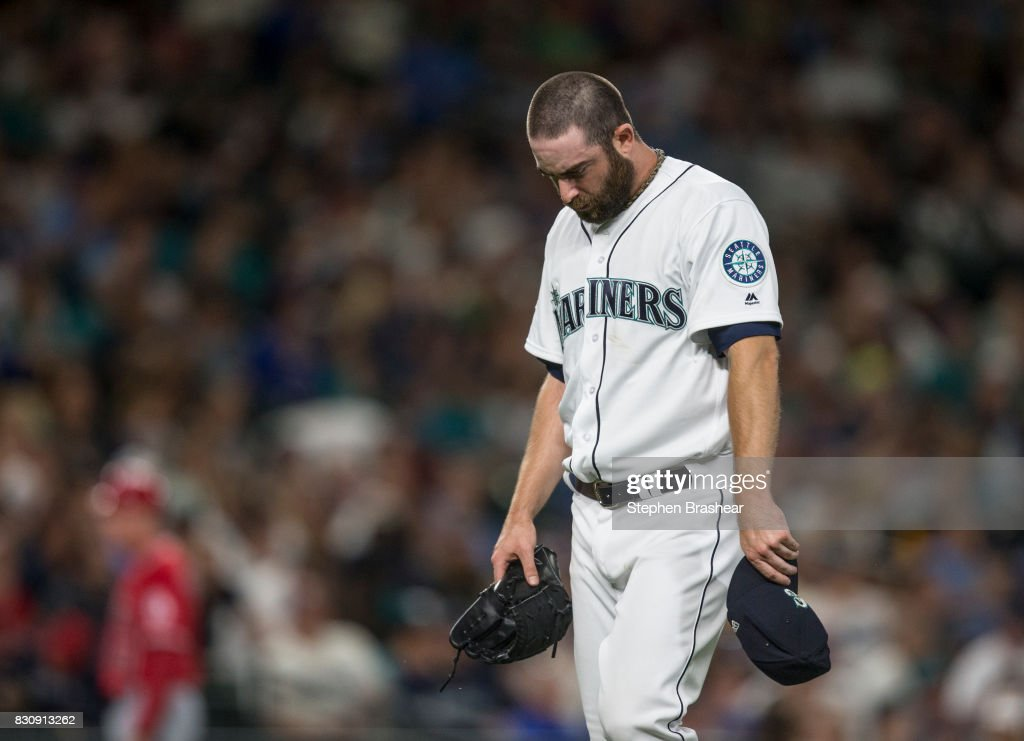 Relief pitcher Tony Zych #55 of the Seattle Mariners walks off the field after pitching the eighth inning of a game against the Los Angeles Angels of Anaheim at Safeco Field on August 12, 2017 in Seattle, Washington. The Angels won 6-3 and Zych got the loss.