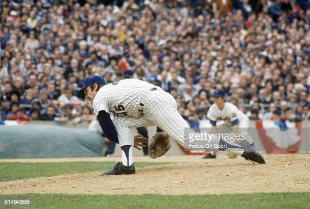 Relief pitcher Tug McGraw of the New York Mets delivers a pitch to home plate at Shea Stadium during the early 1970s in Flushing New York
