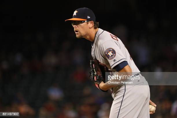 Relief pitcher Tyler Clippard of the Houston Astros pitches against the Arizona Diamondbacks during the eighth inning of the MLB game at Chase Field...